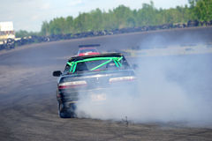 Rear view of drifting car Stock Images