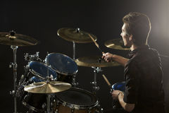 Rear View Of Drummer Playing Drum Kit In Studio Stock Images