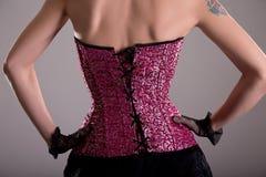 Rear view of elegant woman wearing purple corset Stock Image