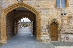 Rear view of the entrance in the castle. Entry into the castle courtyard is through a large arch and castle entrance is through a small door Stock Photography