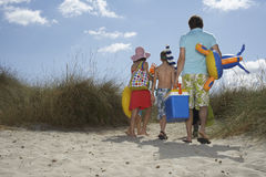 Rear View Of Family With Beach Accessories On Shore Stock Photography