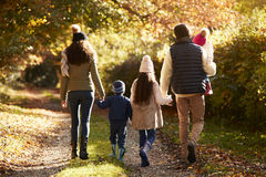 Rear View Of Family Enjoying Autumn Walk In Countryside Stock Images