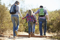 Rear View Of Family Hiking In Countryside Stock Images