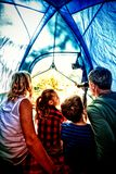 Rear view of family sitting in the tent royalty free stock photos
