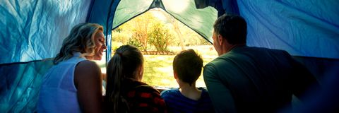 Family sitting in the tent stock photography