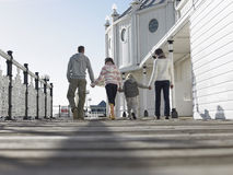 Rear View Of Family Walking Along Pier royalty free stock images