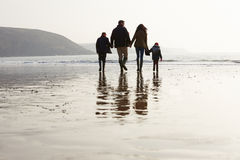 Rear View Of Family Walking Along Winter Beach stock image