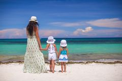Rear view of fashion young mother and two her kids Royalty Free Stock Photos