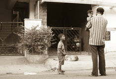 Rear View Of Father and His Children Waiting Outdoor. Stock Photo