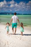 Rear view of father and his two cute daughters Royalty Free Stock Photography
