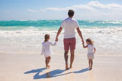 Rear view of father and his two cute daughters Stock Photo