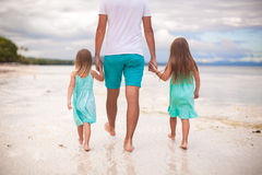 Rear view of father and his two kids walking by Stock Image