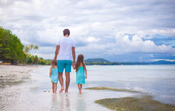 Rear view of father and his two little daughters Stock Photography