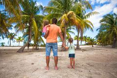 Rear view of father with two kids walking at beach Royalty Free Stock Image