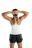 Rear view of female athlete with hands behind head Stock Photos