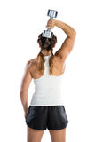 Rear view of female athlete lifting dumbbell Stock Images