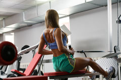 Rear view of female athlete training on simulator Stock Photography