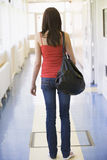 Rear view of female college student in university stock images