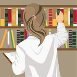 Rear view of female doctor pulls a medical journal out of the bookshelf in doctor`s office. Rear view of female doctor pulls a medical journal out of the Royalty Free Stock Photos