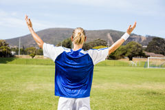Rear view of female football player posing after a victory Stock Photography