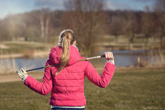 Rear View of Female Golfer with Club on Shoulder Stock Photos