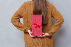 Rear view of female hands holding a gift box Stock Photo