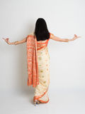 Rear view female in Indian sari dress dancing Stock Photography