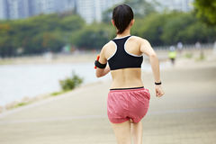 Rear view of a female runner royalty free stock images