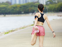 Rear view of a female runner royalty free stock photography