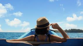 Female tourist enjoys summer travel on a boat stock images