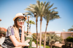 Rear view of female tourist, free happy woman looking at palms. Summer vacation. Royalty Free Stock Photography