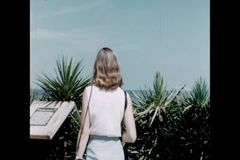 Rear view of female tourist looking at ocean