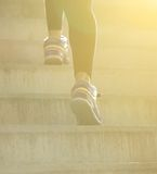 Rear view female walking up stairs. Low angle rear view female walking up stairs Stock Photos