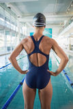 Rear view of fit swimmer by pool at leisure center Stock Images