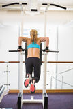 Rear view of fit woman doing crossfit fitness workout gym Royalty Free Stock Photo