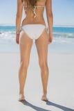Rear view of fit woman in white bikini on beach Royalty Free Stock Photos