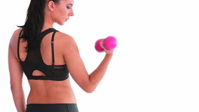 Rear view of fit woman working out with dumbbell Stock Photo
