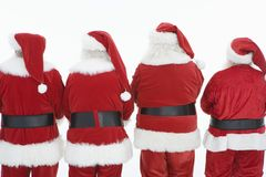 Rear View Of Four Men Dressed In Santa Claus Outfits Royalty Free Stock Image