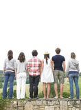 Rear View of Friends Standing on Stone Wall Royalty Free Stock Images
