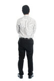 Rear view full length Asian man. Full body rear view of Asian young male in casual business attire, standing isolated on white background Royalty Free Stock Photo