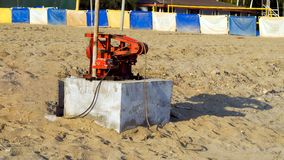 gasoline powered generator on the beach stock photography