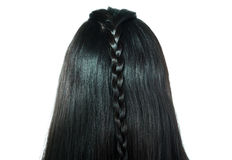 Rear view of girl black shiny plaited hair Royalty Free Stock Photography