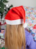 Rear View Of Girl With Christmas Gift Stock Photos