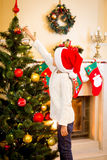 Rear view of girl decorating Christmas fir tree Stock Photography