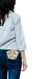 Rear view of a girl with dollars in her back pocket Royalty Free Stock Photography