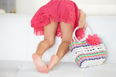 Rear View Of Girl Playing On Sofa. At Home royalty free stock images