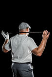 Rear view of golf player holding a golf club Royalty Free Stock Photo