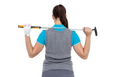 Rear view of golf player holding a golf club. On white background Royalty Free Stock Photo