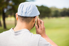 Rear view of golfer calling Royalty Free Stock Photos