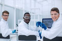 Rear view.a group of scientists discusses the results of the experimen. T. the concept of teamwork Stock Images